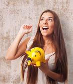 Woman holding a piggy bank — Stock Photo
