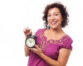 Woman holding an alarm clock — Stock Photo