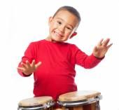 Boy playing on bongos — Stock Photo
