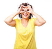 Mature woman doing a glasses symbol — Stock Photo