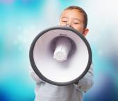 Boy shouting with the megaphone — Stock Photo