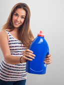 Girl holding a detergent — Stockfoto