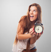 Pretty woman holding a clock — Stock Photo