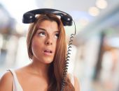 Young woman thinking about a call — Stock Photo