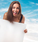 Woman holding a white banner — Stock Photo