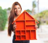 Woman holding a house design — Stock Photo
