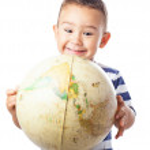 Child holding a world globe — Stock Photo #67004507