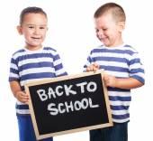 Children  holding a blackboard — Foto de Stock