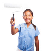 Girl holding a paint roller — Stockfoto