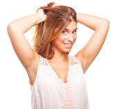 Girl combing her hair — Stock Photo