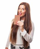 Woman holding a chocolate bar — Stock Photo
