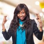 Black woman crossing fingers — Stock Photo #69995227