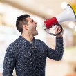 Man using megaphone — Stock Photo #69995353
