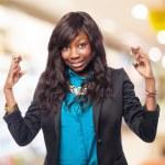 Black woman crossing fingers — Stock Photo #69995849