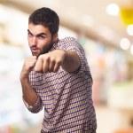 Young man punching — Stock Photo #69996179