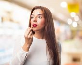 Woman using lipstick — Stock Photo