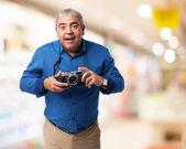 Man using camera — Stock Photo
