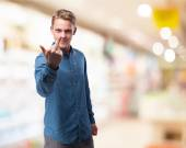 Happy man shows insult sign — Stock Photo