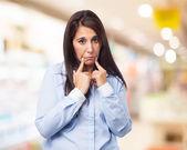 Woman shows sad gesture — Stock Photo