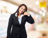 Businesswoman shows calling sign — Stock Photo