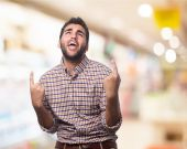 Young man pointing up — Stock Photo