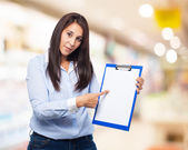 Woman holding inventory — Stock Photo