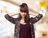 Young woman covering her ears — Stock Photo