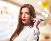 Elegant woman with brush — Zdjęcie stockowe