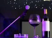 Glass of wine and microphone — Stock Photo