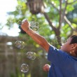 Childen playing with bubbles — Stock Photo #62852651