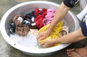 Hands wash stain of dirty clothes — Stock Photo