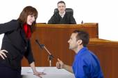 Defendant with lawyer in courtroom — Stock Photo