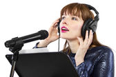 Woman singing or reading a script for voice over — Стоковое фото