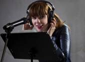 Singer reading lyrics — Stok fotoğraf