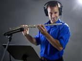 Male flute player in a recording studio — Stock Photo