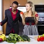 Couple preparing in the kitchen — Stock Photo #61633095