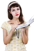 Girl with sketchbook and pencil — Stock Photo