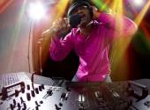 Cool African American male DJ playing music at a party — Stock Photo