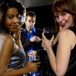Women seducing man at bar — Stock Photo #63285027