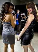 Women seducing man at bar — Stock Photo
