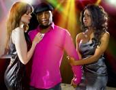 Man with two women at nightclub — Stock Photo