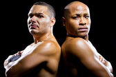 Black boxer with latino opponent — Stock Photo