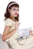 Female writing on  diary — Stockfoto