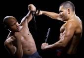Martial artists sparring with Kali Escrima — Foto de Stock