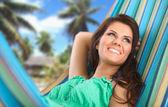 Beautiful Young Woman relaxing in hammock — Stock Photo