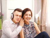 Young couple relaxing and listening music together — Stock Photo