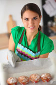 Woman is making cakes in the kitchen — Stockfoto