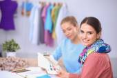 Modern young fashion designers working at studio. — Stock Photo