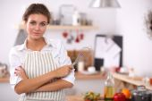 Woman with corolla standing in the kitchen — Stock Photo