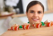 Woman is making cakes in the kitchen — Stock Photo